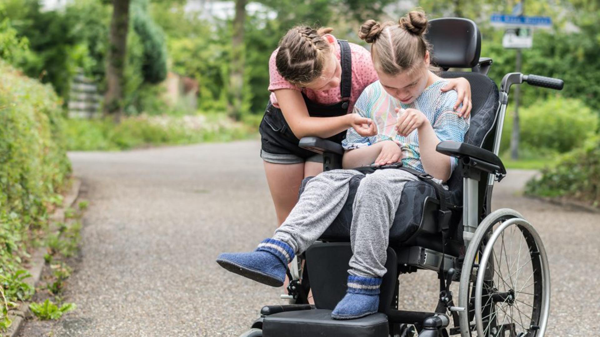 Det Outsagda Flicka i rullstol